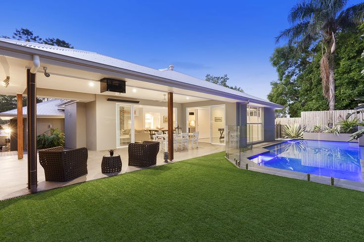 GREENSLOPES 7 Merinda Street...Finished with Astroturf, the tidy yard overlooks the sparkling in-ground saltwater pool with luminous lighting.
