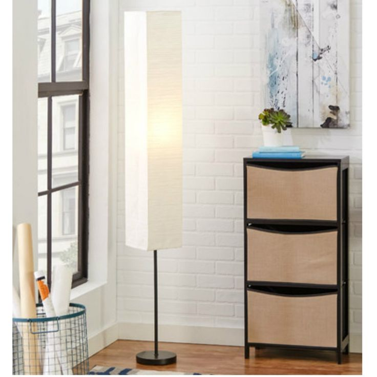 "Chic & Modern White Rectangular Shade Floor Lamp for Living Room, Bronze Finish. Measures: 62.5"" H x 8"" W x 8"" D. White Rectangular Paper Shade (removable). Bronze finish. On / Off switch. Requires 100 W incandescent bulb (not included)."