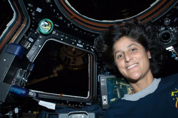 Sunita Williams holds women's records for longest spacewalk, number of spacewalks, and most spacewalk time. She also cut her hair for Locks of Love while in space and was the first person to run a marathon AND a triathlon in space.