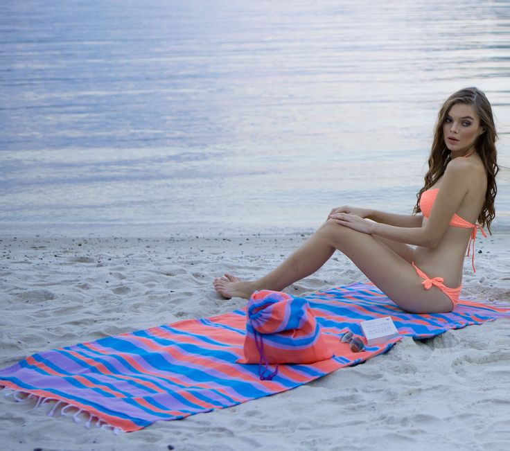 Cheer up with our 100% cotton double sided Turkish Beach Towel. This soft and fashionable terry towel with color options comes with its bag.
