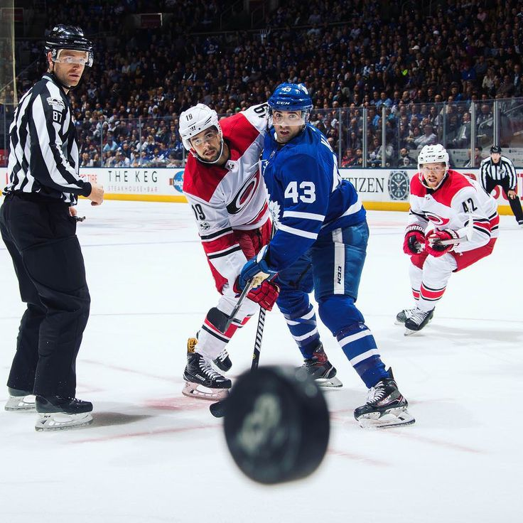 PsBattle: This shot from the Leafs-Hurricanes game by Mark Blinch (x-post r/hockey) : photoshopbattles