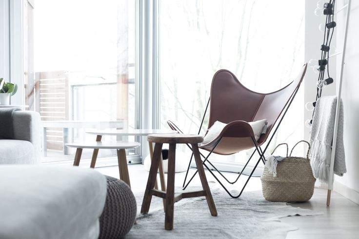 A modern living room with nordic and boho influences.