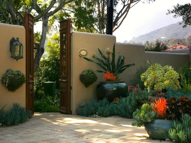 Use Structures to Define Spaces - 20 Outdoor Structures That Bring the Indoors Out on HGTV