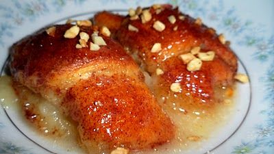 7-Up Apple Dumplings - Crescent rolls stuffed with apple, cinnamon sugar and chopped nuts cooked in a buttery syrup.