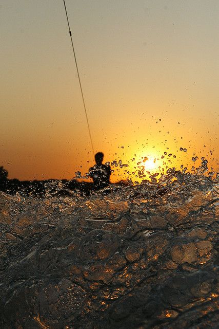 sunset & water by Heidi Harms, via Flickr.  Wakeboarding at sunset.