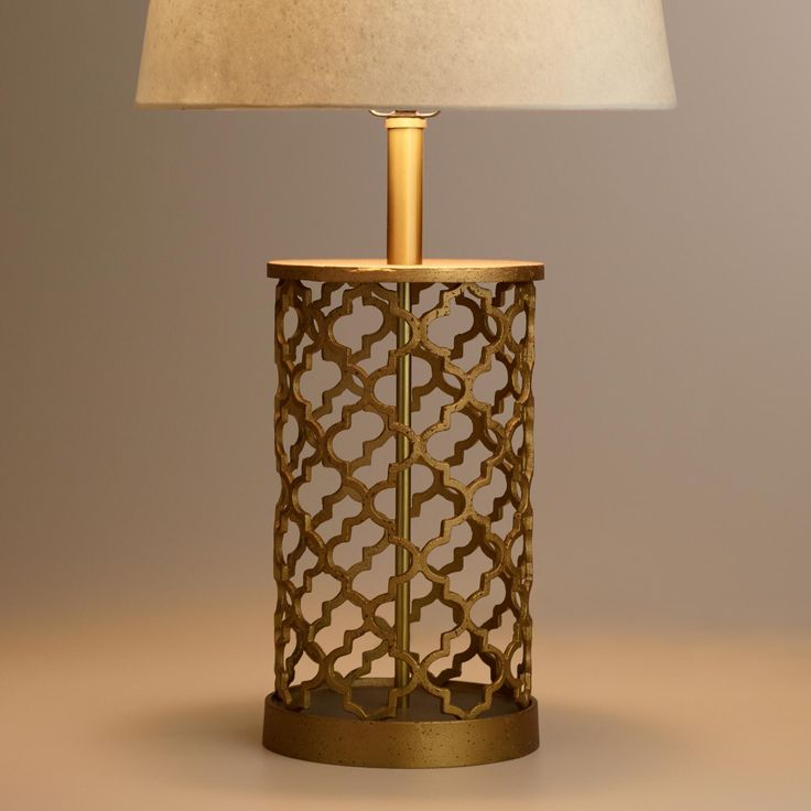 Brighten any nightstand, side table or desktop with the exotic appeal of our exclusive Distressed Gold Moroccan Table Lamp Base. Crafted by artisans in India of cast metal, it features a sophisticated distressed gold finish - variations in its design mark it as truly unique. Pair this alluring lamp base with any of our mix-and-match table lamp shades to complete its appeal.