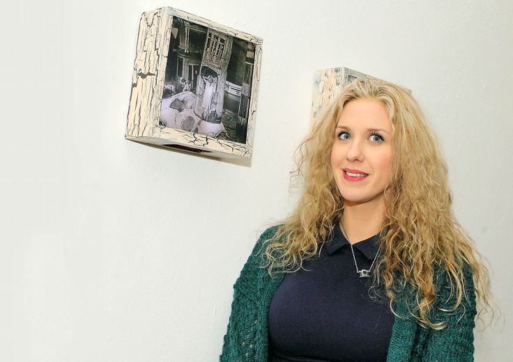 Exhibitor Amii McGuinness next to her exhibit called 'This Must Be The Place'- www.noelbrownephotographer.com
