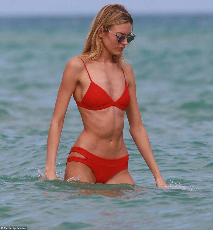 Martha Hunt turns up the heat in Miami with red bikini #dailymail