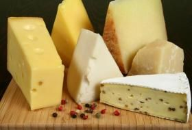 There are 400 types of French Cheeses, all classified by the type of milk (cow, goat or ewe) and whether or not it is pasteurized. Chevre` is goat cheese - paler, the lighter the flavor. Boursin is a garlic (ail) soft cheese. Brie & Camembert are the most popular soft cheeses. Emmental is lightest of the hard cheeses, often served on sandwiches; Cantal is likened to Cheddar; Mimolette is similar to Edam. The longer a cheese has aged, the sharper the flavor.