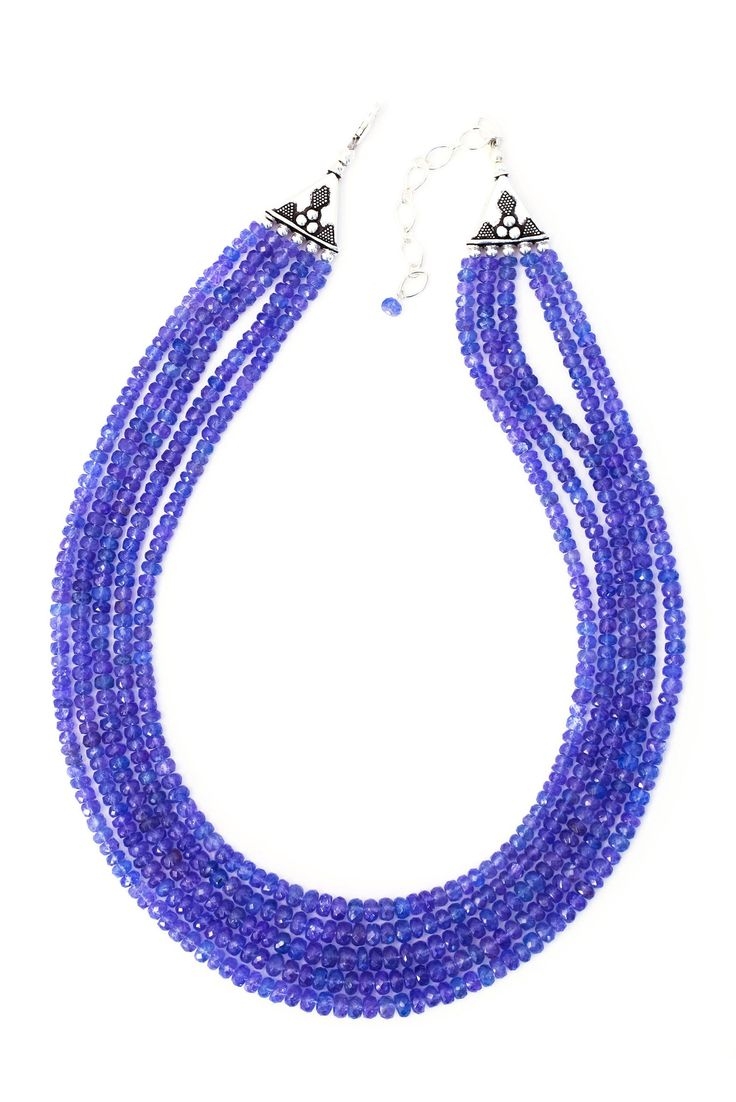 Royal Blue Tanzanite Necklace Five strands of royal blue tanzanite -- a precious and highly sought gemstone only to be found in Tanzania -- come together to form a striking necklace with sterling silv