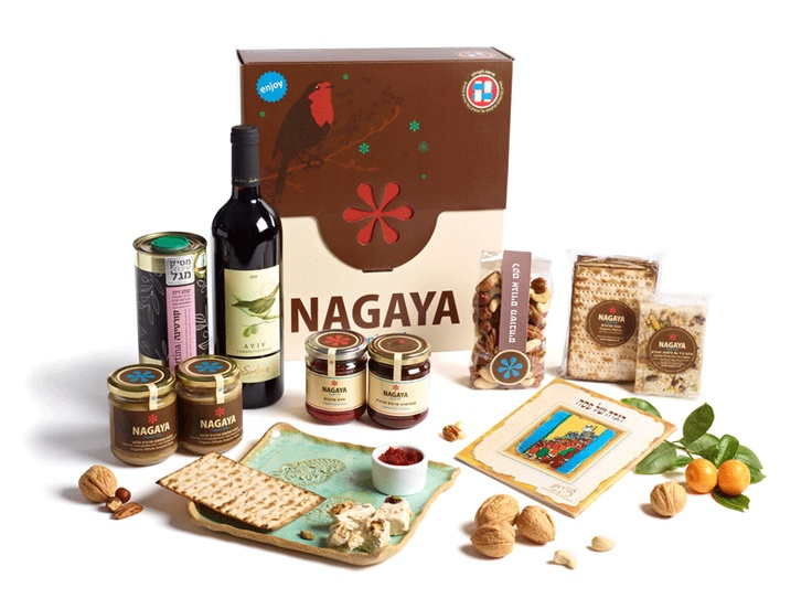 A deluxe gift basket with a beautifully illustrated Hagada made by the Chase foundation, a handmade ceramic plate for Matza, olive oil, wine, comfiture, halva, charoshet and more Kosher Chief Rabbinate