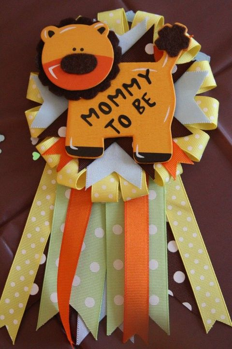 baby shower pin...replace lion with turtle, and colors pink/green and we got something for brookie :)