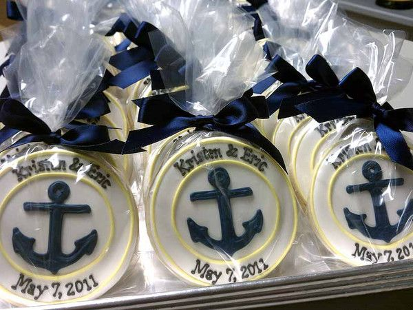 Nautical Cookie favors. Could be a sea shell, a seahorse, a fish in the middle of the cookie