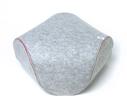Ufo is a fun little object from Italian designer and illustrator Luca Cozzi. The multifunctional design not only acts as a bean bag-like place to sit, but it can also be used flat as a comfy place to relax on the floor. It's made from two triangular pieces of gray felt that zip together to create a three-dimensional form.