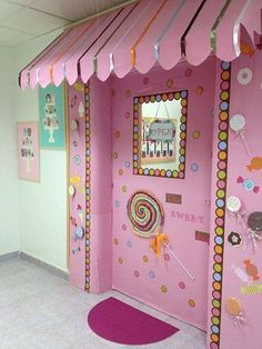 """Creating a candy store theme for a classroom door is a yummy idea. It would be great to do when reading """"Charlie and the Chocolate Factory"""" by Roald Dahl."""
