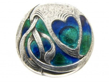 silver and enamel button that was designed by Archibald Knox for Liberty's of London in 1900-1910