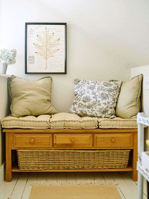 Voila! A cozy seating area appears thanks to cushions placed on the coffee table.    How to Get the Look:    Buy box cushions for cushy seating (and don't forget throw pillows).  Add wall art and a long, woven basket for storage.