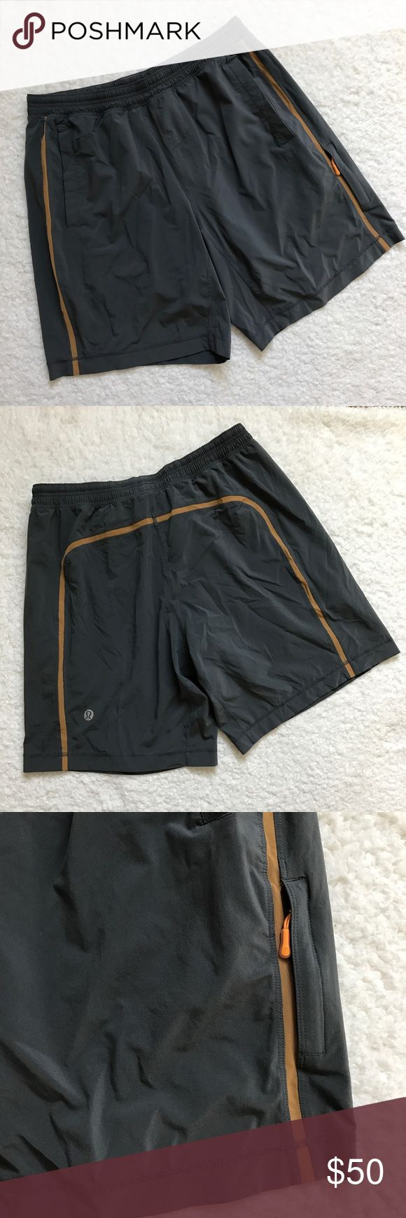 "Lululemon Men's Gray Athletic Shorts In good condition.  There are a few threads at the hem that are showing some wear.  This is not causing the hem to come undone.  Built in shorts lining.  Gray with orange mesh stripe.  Elastic waist with drawstring.  Size XL.  Inseam is 9"". lululemon athletica Shorts Athletic"