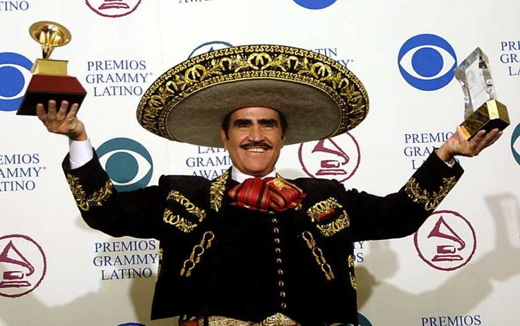 """Performer Vicente Fernandez holds up two trophies, one a Legend Award and the other a trophy for Best Ranchero Album """"Mas Con El Numero Uno,""""  at the 3rd Annual  Latin Grammy Awards on Sept. 18, 2002, at the Kodak Theater in Hollywood, Calif."""