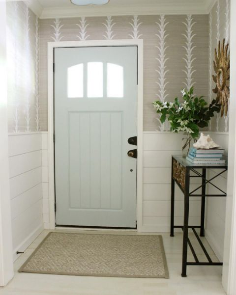 Celerie Kemble's Acanthus Stripe grasscloth makes an elegant first impression in entryway by Sherry H Designs. Share how you use Schumacher with #Schustagram.
