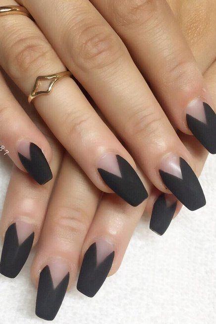 Black matte negative space nails.