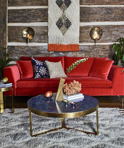 Fall Decorating Tip: Don't shy away from bright colors—even in winter. Start small by adding a vibrant throw pillow alongside a patterned one in a more subdued hue to tone down the initial impact. If you do go all in with a bold color sofa, let it be the star of your space and keep the accent furniture finishes consistent.