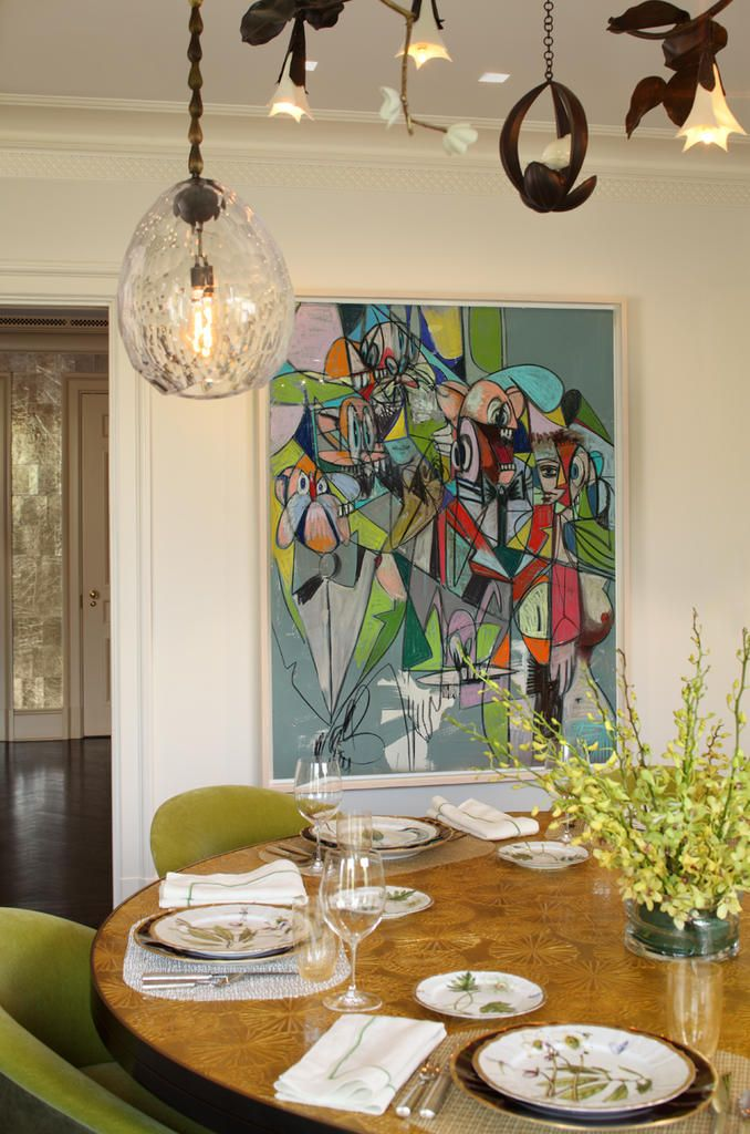 We've been noticing a trend happening in dining spaces... And that's the addition of big, bold, vibrantly toned art. This is a great example of this trend. Not only does it give diners something to visually enjoy, but bright colors also help to maintain a festive mood. So, next time you're looking to spice up your dinner parties, go for some exciting new, large-scale custom framed artwork. You won't regret it and your guests will appreciate it!