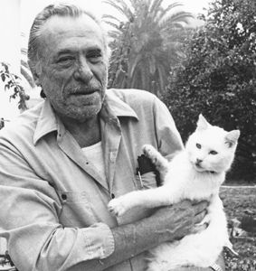 """Is this cat Charles Bukowski is holding the """"white cross-eyed tailless"""" tom he memorialized in """"The History Of One Tough Motherfucker""""?"""