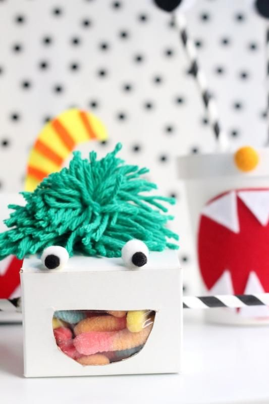DIY monster favor boxes how-to. Fill with favorite gummy creatures.