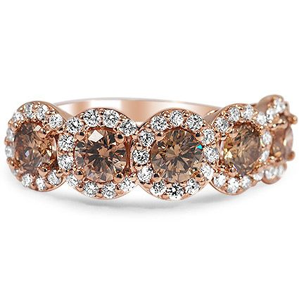 Five Halo Champagne Diamond Ring from Brilliant Earth starting at 4,900...This breathtaking ring features five shimmering champagne diamonds, each encircled by a halo of brilliant white diamonds. Romantic rose gold adds to the antique feel.