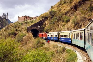 Toy train entering a tunnel, Kalka, Himachal Pradesh, India - Panoramic Images/Panoramic Images/Getty Images