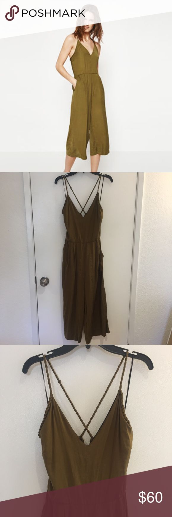 """Zara Jumpsuit Olive green jumpsuit that zips up the back. Silky material. In great condition. Worn only 3 times. Waist is 11.5"""" and chest is 15"""" wide. Can be dressed up or worn casually Zara Dresses"""
