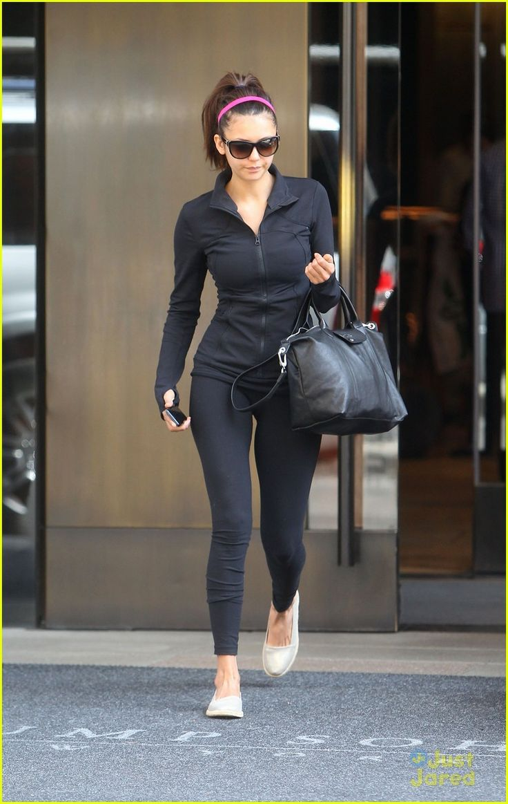 nina dobrev yoga class nyc 08, Nina Dobrev rocks a high ponytail while leaving her hotel on Sunday afternoon (May 5) in New York City.    The 24-year-old Vampire Diaries actress, wearing a Kitsch…