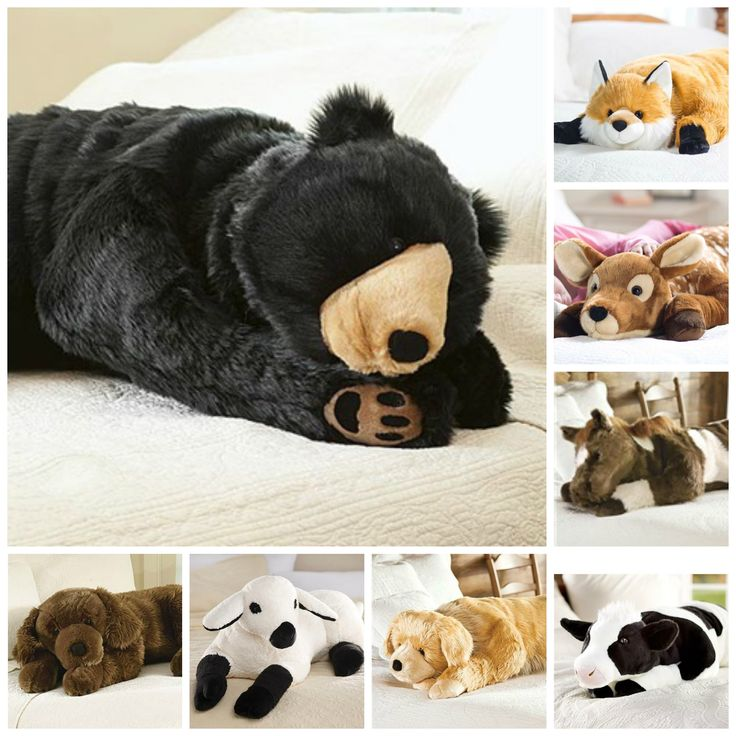 "Curl up with an Animal Hug Body Pillow and relax in snuggly comfort. About the size of a real cub, this plush bear is crafted with super-soft, super-dense ""fur"" fibers. Choose from many different designs - find your favorite animal body pillow today."