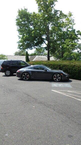 Porsche in work parking lot