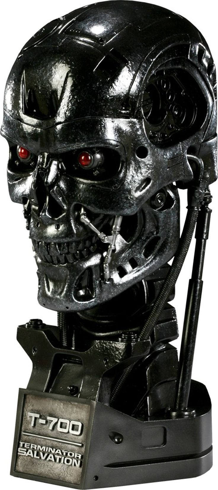"""*T-700 bust from the blockbuster film Terminator Salvation *Light-up eyes and weathered metallic finish *Life-size bust, 13"""" H X 8"""" W X 8"""" L *Hand-crafted with outstanding quality & attention to detai"""