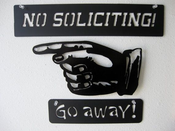 No Soliciting metal wall decoration with the vintage hand and Go Away signs    Great decoration for an office or for the guy with a man cave