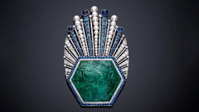 French designer Paul Iribe's aigrette, circa 1910, has a Mogul-era carved emerald set in platinum with a plume of diamonds and sapphire and pearl beads. Courtesy of Servette Overseas Ltd. and the New York Metropolitan Museum of Art.
