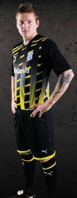This is Cardiff City FC's new third jersey for the 2011/2012 Championship season. Cardiff's new third shirt 11/12 is a black and yellow creation from the Puma stable and was officially …