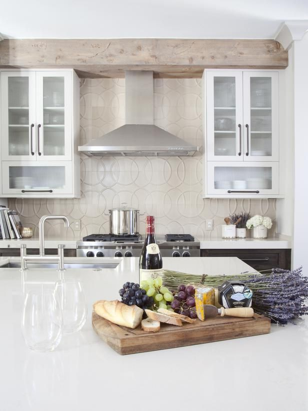 I like the rustic beam to hide the bulkhead, I also like the styling of the island, staged.