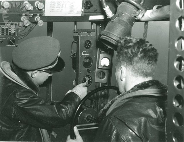 Two US Navy Airship Squadron 24 crew members steering their K-28 - us navy address for resume