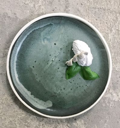 EIRA -tableware. Project for a customer in collaboration with Heidi Aulikki. All plates with various sizes and glazes are handmade in Helsinki.