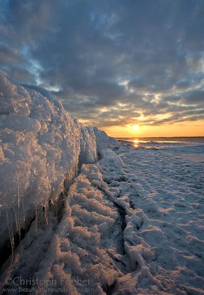 winter-sunrise-illuminates-ice-and-snow-on-frozen-Lake-Ontario-Kingston-Canada