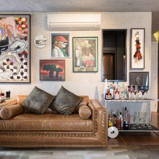 Eclectische woonkamers van Motirõ Arquitetos