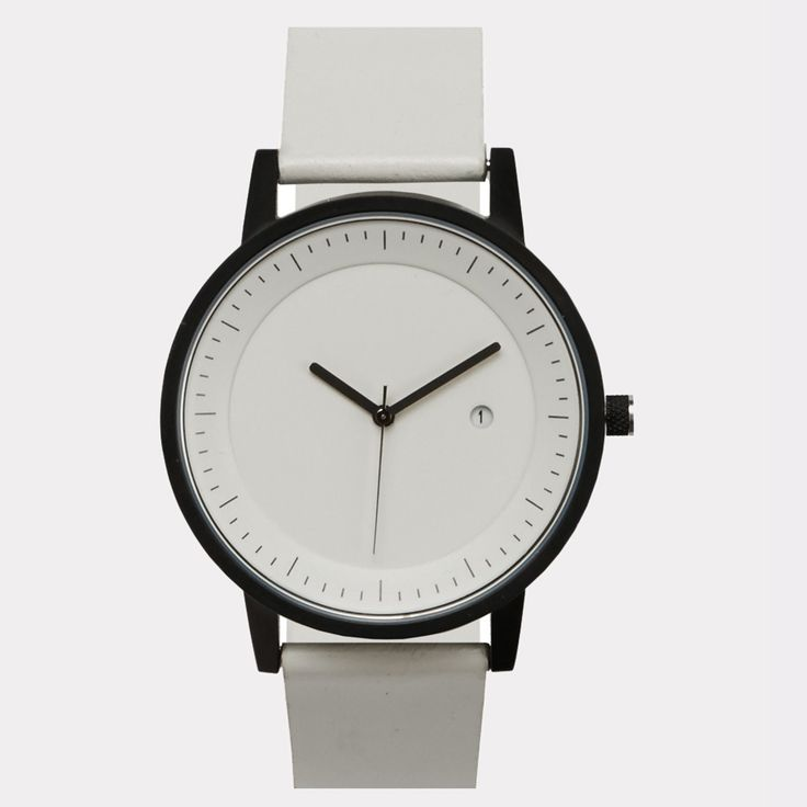 Simple Watch Company White & Black Earl Watch: Simple Watch Company Earl Watch in white & black. Constructed with premium Japanese movements, scratch resistant glass and backed by a two-year guarantee. Contemporary design meets a classic colour palette with the Earl. Unisex size and design.