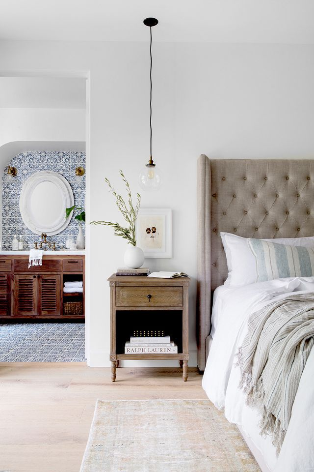 The master bedroom is where you really see the modern and traditional merge. The neutral tones and soft textures of the bed fuse effortlessly with the blue European floor to wall tiles of the...