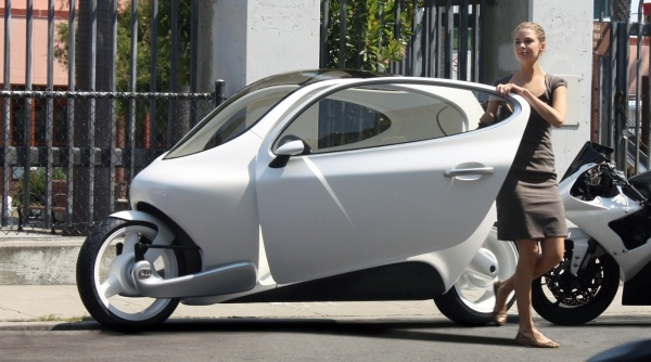 """""""Now imagine a vehicle that's smaller than a Smart Car, nearly a third of the price of a Nissan Leaf, safer than a motorcycle with a range capacity that just lets you drive and won't ever tip over? What you get is Lit Motors' C-1, the world's first gyroscopically stabilized, two-wheeled all-electric vehicle. Oh, and it will talk to your smartphone and the cloud."""""""