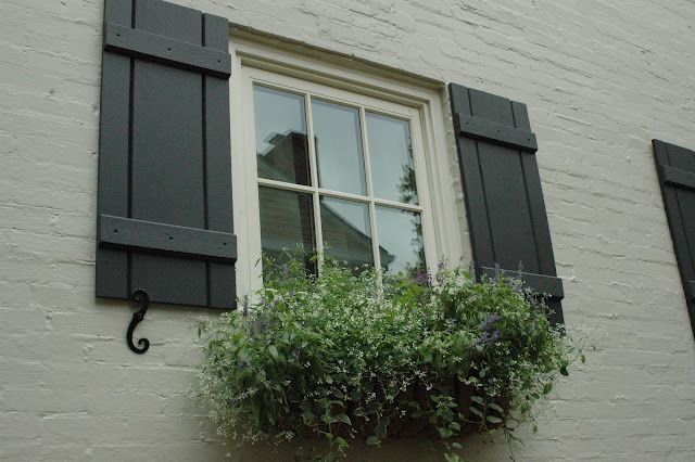 Picture of Benjamin Moore 'Wrought Iron' on shutters, Benjamin Moore 'Hazy Skies' on brick, & Porter Paint 'Soft Antique White' on window trim -- beautiful combination!