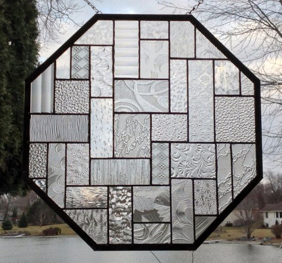 This stained glass window panel is a larger octagon design done in all clear glass. The panel size is approximately 18 x 18.. The patina on the solder is done in black with the zinc frame left silver tone. There are rings so that the piece can be hungas shown. To see more abstract geometric panels http://www.etsy.com/shop/sghovel?section_id=10763111 To see all of my items sghovel.etsy.com/ Shipping is either via UPS, FedEx or USPS priority mail. Insurance is a...