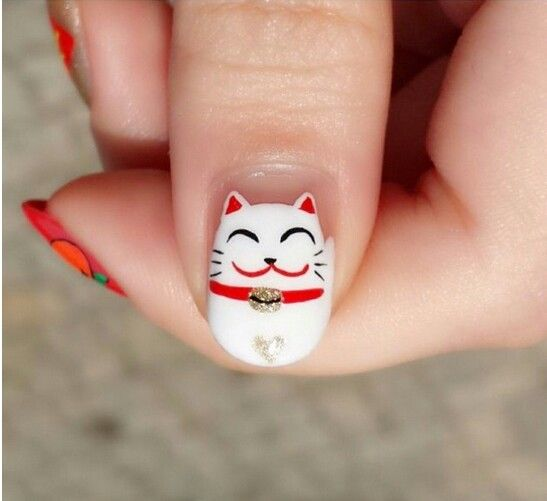 Maneki neko nail art                                                                                                                                                      More
